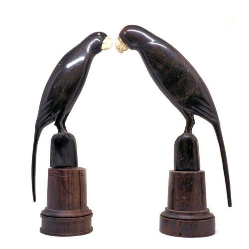 Carved horn birds