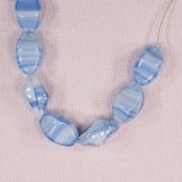 Light blue and white pinch beads