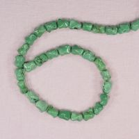 8 mm to 10 mm by 6 mm irregular dog bone green beads